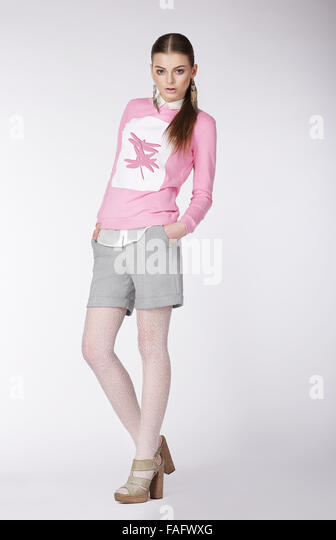 Expressive young model in casual style on gray background. - Stock Image