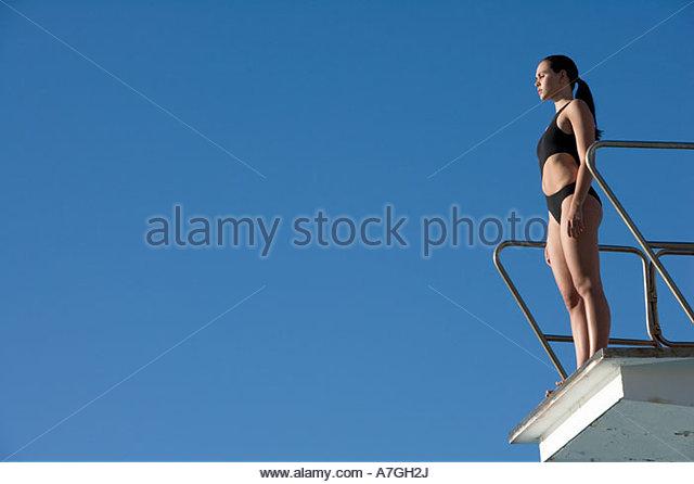 Woman diving board