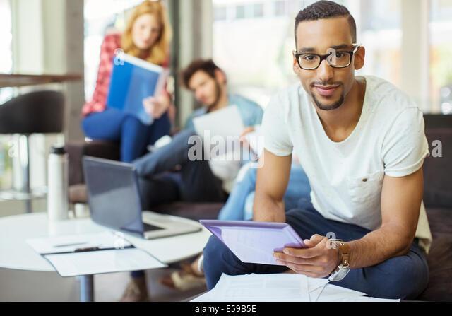 Man using digital tablet in office - Stock Image