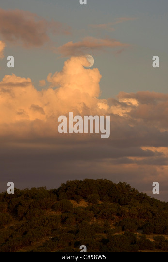 Unusual cloud formation with full moon - Stock Image