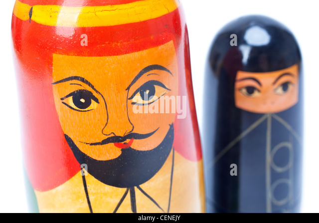Arab Islamic Muslim man and woman nesting dolls in close up, the woman is wearing a black burka - Stock Image