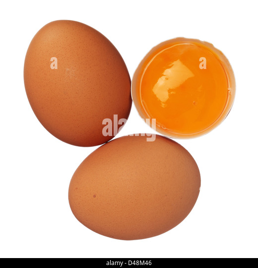 Whole eggs and egg yolk in shell isolated on white - Stock Image