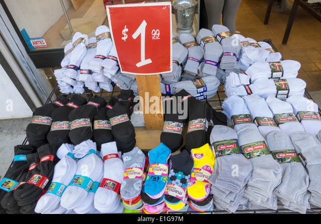 California CA Los Angeles L.A. Downtown shop store retail business shopping sidewalk sale bargain socks pack price - Stock Image