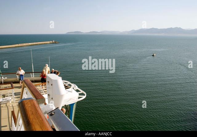 Passengers on a Cruise Ship leaving Cagliari Port, Sardinia, Europe, - Stock Image