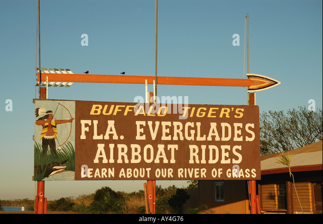 Florida Everglades Miccosukee Seminole Indian airboat ride sign on the Tamiami Trail - Stock Image