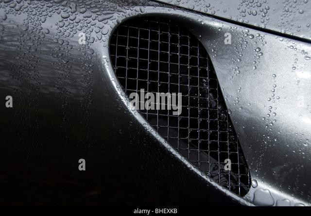 Air In-take of a 2007 Ferrari F430 Spyder in metallic grey. - Stock Image
