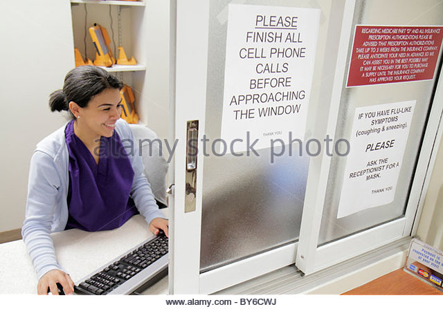 Miami Beach Florida Mount Mt. Sinai Medical Center centre hospital doctor's office Hispanic woman receptionist - Stock Image