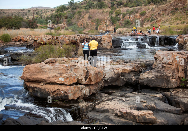 Tourists taking photos at Bourkes Luck,Mpumalanga - Stock Image