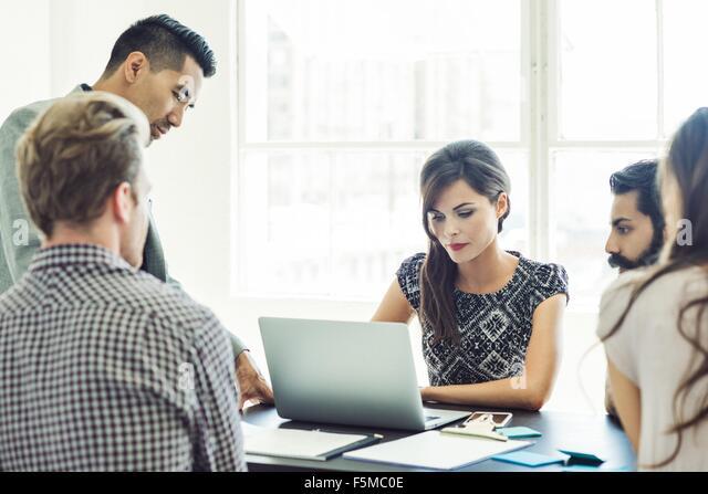 Business people in brainstorming meeting - Stock Image