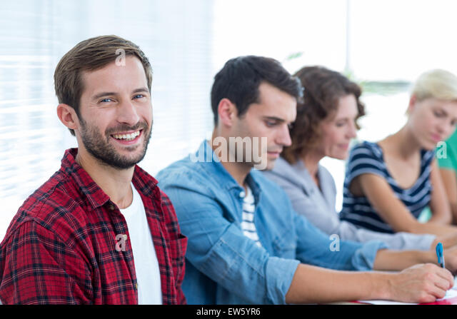 Creative business people in meeting - Stock Image