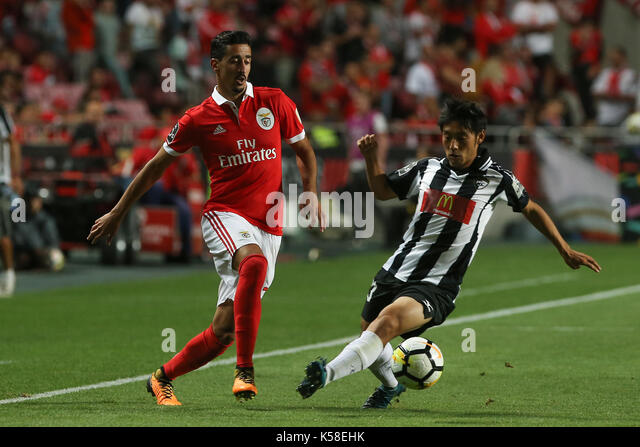 Benfica«s defender Andre Almeida from Portugal (L) and Portimonense«s forward Shoya Nakajima from Japan - Stock Image