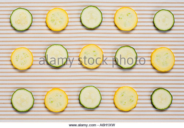 Row of courgette slices - Stock Image