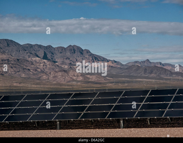 Solar panels under blue sky - Stock Image