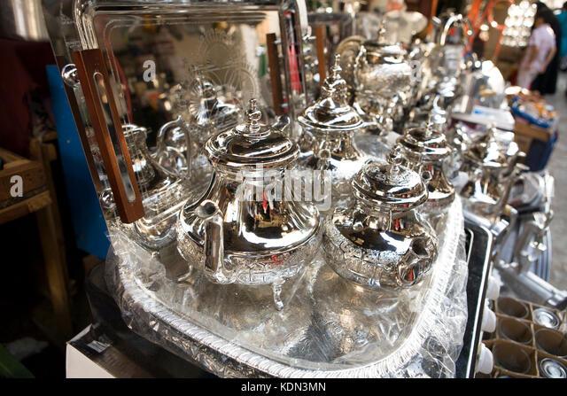Silver Tea Pots at Tetouan souk, Morocco. Shinny tray for sell - Stock Image