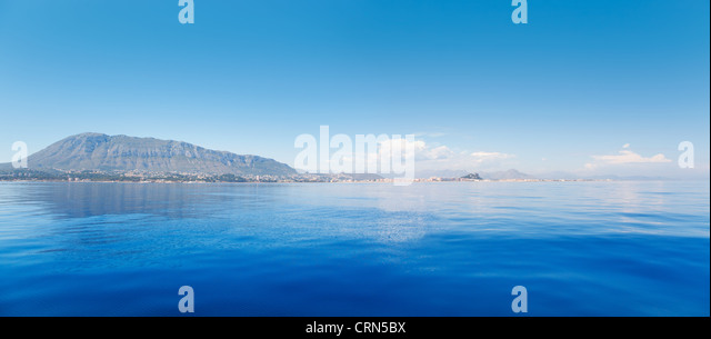 Alicante Denia view from blue calm Mediterranean sea in Spain - Stock Image