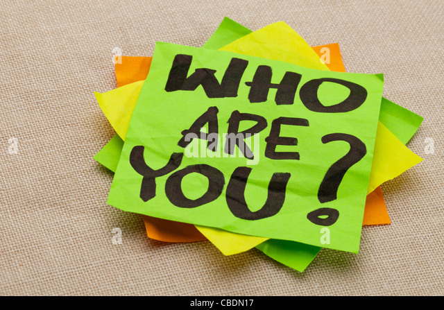 Who are you question - handwriting on a green sticky note - Stock Image