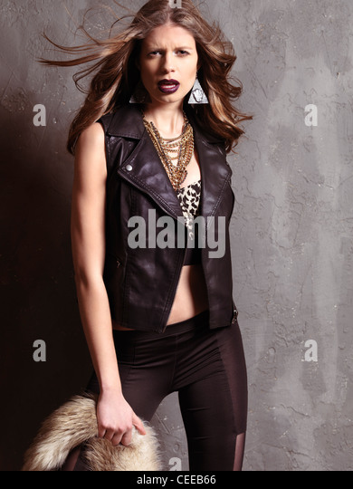 Edgy fashion photo of a young woman wearing 1990s grunge fashion style clothing - Stock Image