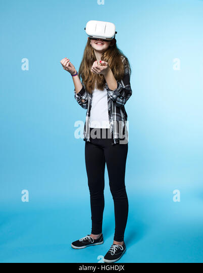 Girl 12- 14yo wearing virtual reality head set goggles, VR Glasses - Stock Image
