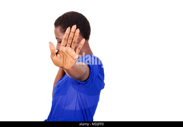 Young woman asking to stop filming her by waving her hand. - Stock Image