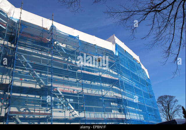 scaffolding at building site against blue skies - Stock Image