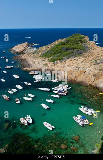 Cove filled with pleasure boats, Sa Tuna, near Begur, Costa Brava, Catalonia, Spain, Mediterranean, Europe - Stock Image