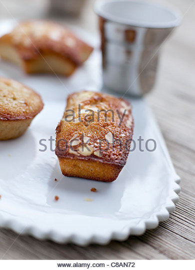 Different-shaped almond Financiers - Stock Image