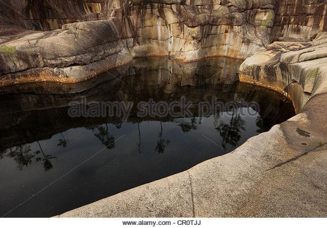 Jettegryte with reflections at Reinsfoss in Nissedal, Telemark fylke, Norway. - Stock-Bilder