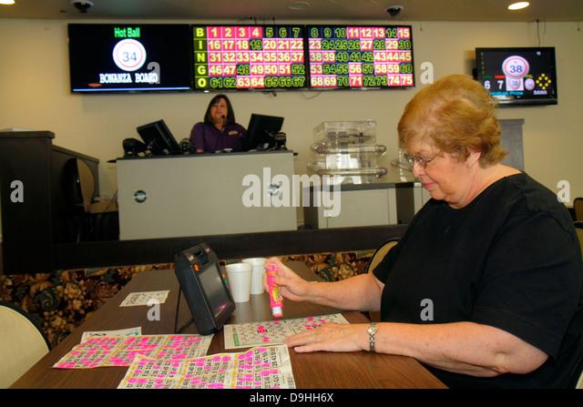 Nevada Las Vegas Plaza Hotel & Casino bingo gambling gamblers game luck woman electronic card player - Stock Image