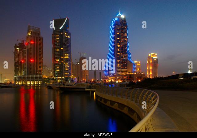 Night Scene of Hotels And Marina Dubai United Arab Emirates - Stock Image