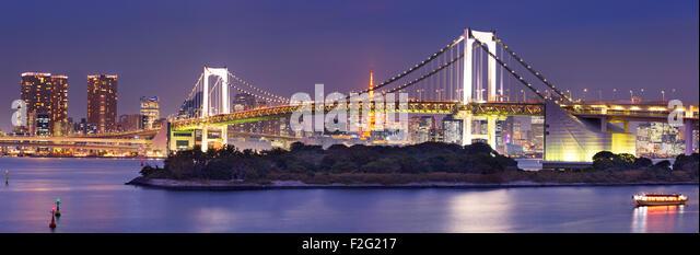 Tokyo Rainbow Bridge over the Tokyo Bay in Tokyo, Japan. Photographed at night. - Stock Image