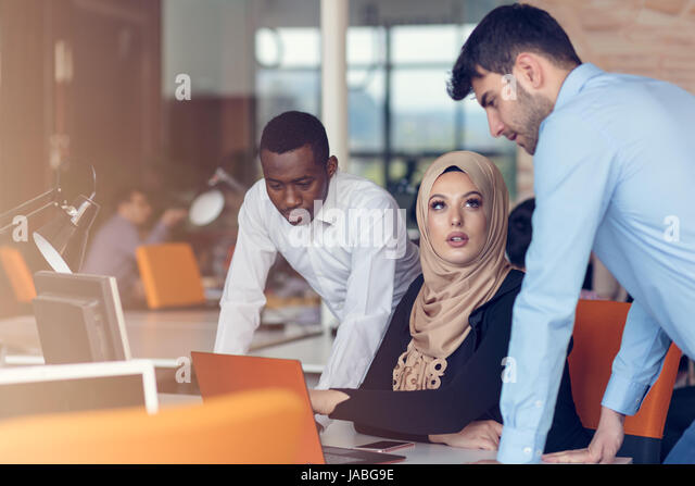 Multiracial contemporary business people working - Stock Image