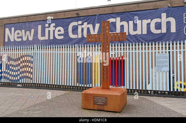 Belfast Falls Rd New Life City Church and iron cross - Stock Image