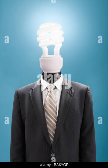Businessman with energy saving lightbulb as head - Stock Image