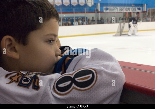 Dave Stepherns (5), wearing Ovechkin's number 8 Jersey is watching Alexander Ovechkin play at the practice game - Stock Image