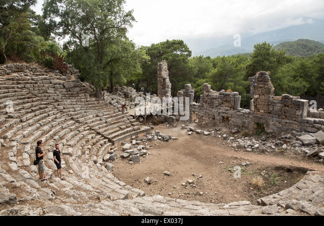 Tourists at ruins of ampitheatre at Phaselis, Lycian way, Turkey - Stock Image