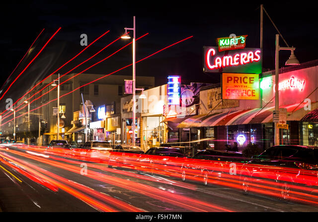 Kurt's Camera Corral neon sign and light streaks on Central Avenue (formerly Route 66), Nob Hill, Albuquerque, - Stock-Bilder