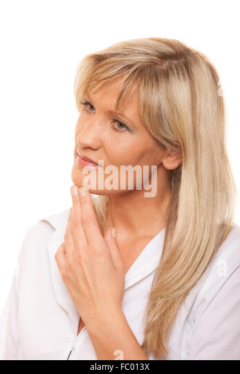 Portrait thoughtful pensive mature woman isolated - Stock Image
