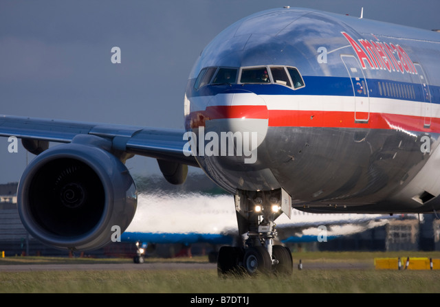 American Airlines Boeing 777-223/ER taxiing for departure at London Heathrow airport. - Stock Image