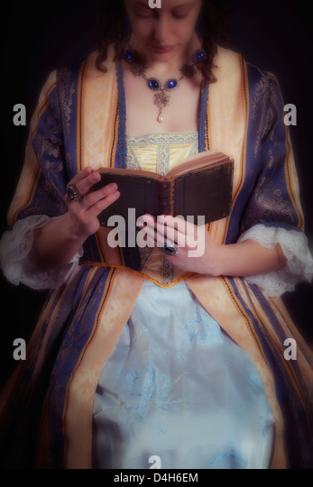 a victorian lady reading a book - Stock-Bilder