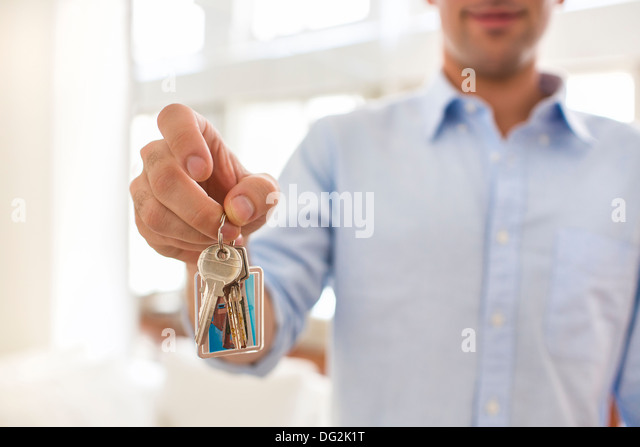 male at home keys smiling hand - Stock Image