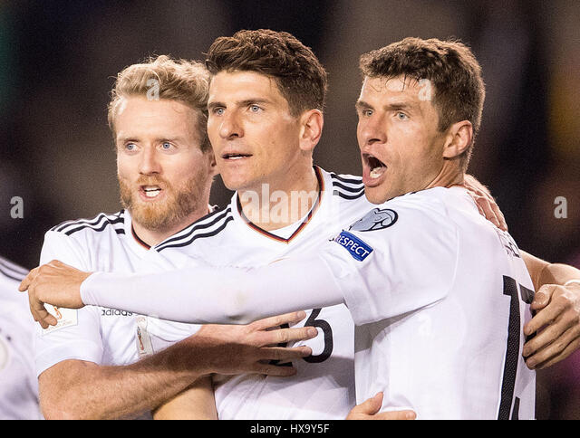 Baku, Azerbaijan. 26th Mar, 2017. Germany's Mario Gomez (C) celebrates his 3-1 goal with teammates Andre Schuerrle - Stock Image