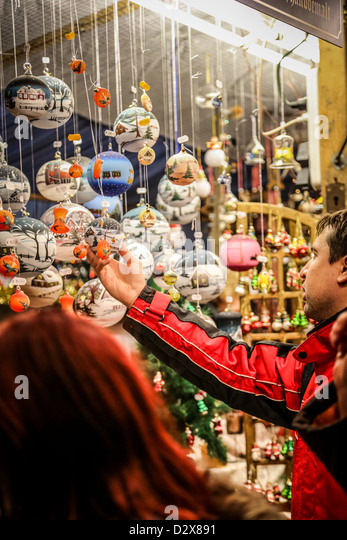 Man holding Christmas ornament in shop In Marienplatz, Munich Germany - Stock Image
