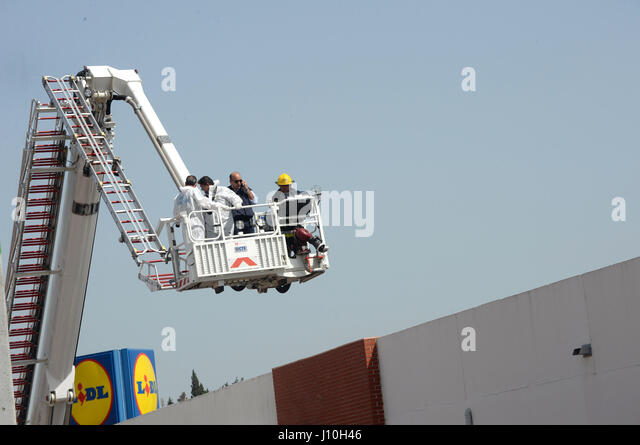 Lisbon, Portugal. 17th Apr, 2017. Firefighters and rescuers work at the crash site of a small Swiss-registered airplane - Stock Image