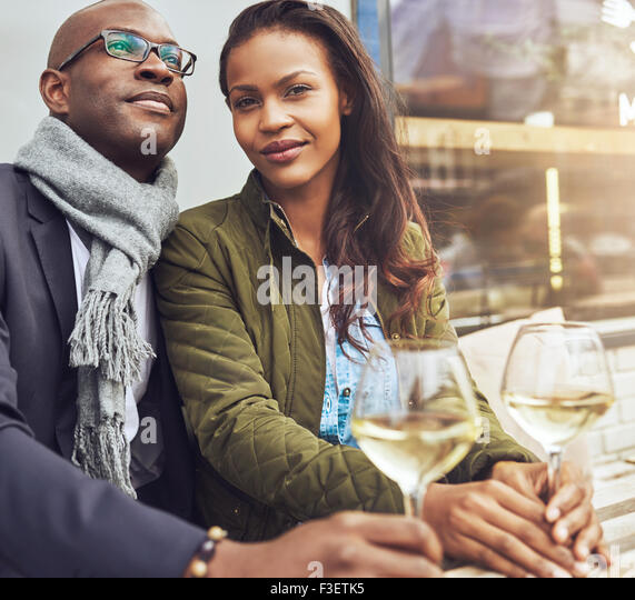 Afro american couple dating, woman looking straight at camera - Stock Image