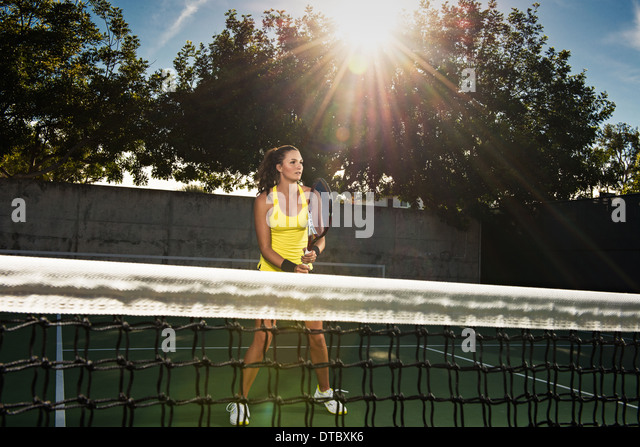 Female tennis player and net - Stock Image
