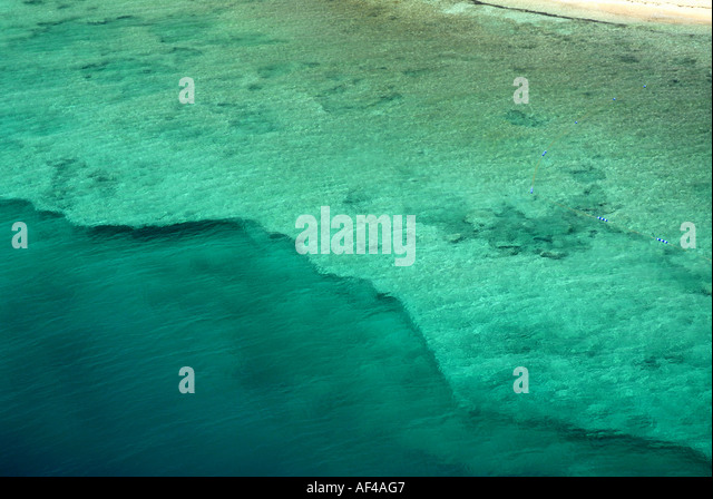 Grand Turk Island Turks and Caicos Islands clear deep water dropoff near coral shore - Stock Image