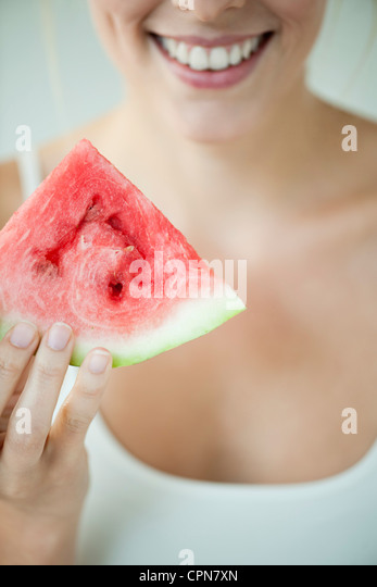 Woman holding slice of watermelon - Stock-Bilder