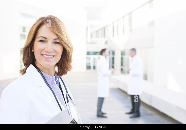 Portrait of smiling doctor - Stock Image