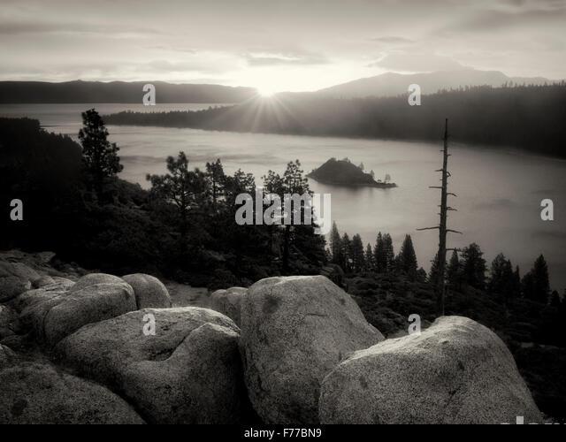 Sunrise and granite boulders at Emerald Bay, Lake Tahoe, California - Stock Image