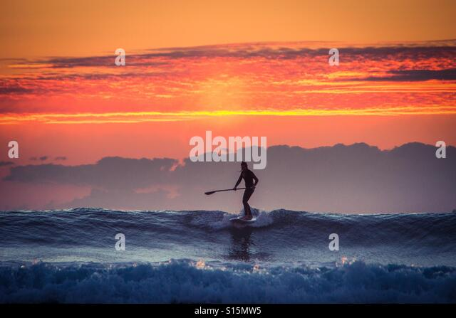 Sunset surfing - Stock-Bilder